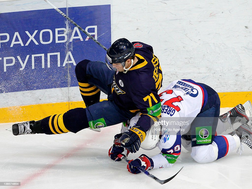 Jonas Andersson #71 of the Atlant collides with Denis Grebeshkov #73 of the SKA during the KHL Championship 2011/2012 on January 5, 2012 at the Arena Mytishchi in Mytishchi, Russia. The CKA defeated the Atlant 3-4.