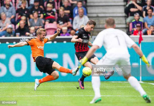 Jonas Bager of Randers FC and Jonas Borring of FC Midtjylland compete for the ball during the Danish Alka Superliga match between FC Midtjylland and...