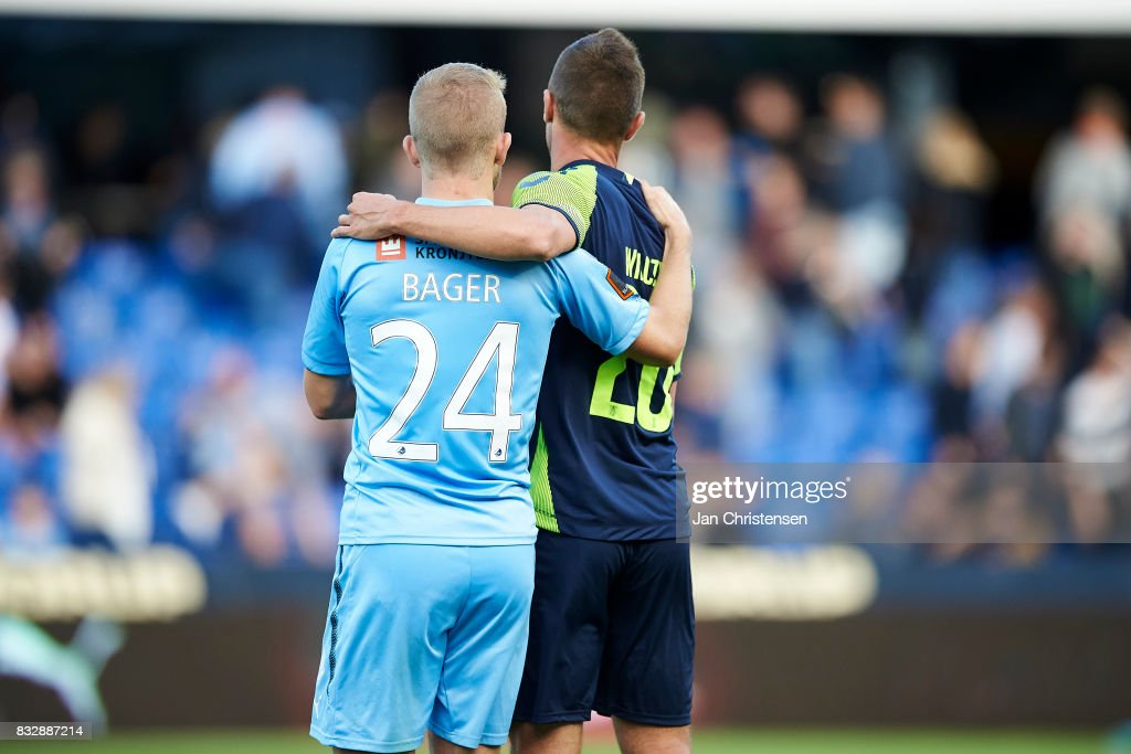 Jonas Bager of Randers FC and Kamil Wilczek of Brondby IF gives a hug after the Danish Alka Superliga match between Randers FC and Brondby IF at BioNutria Park Randers on August 13, 2017 in Randers, Denmark.