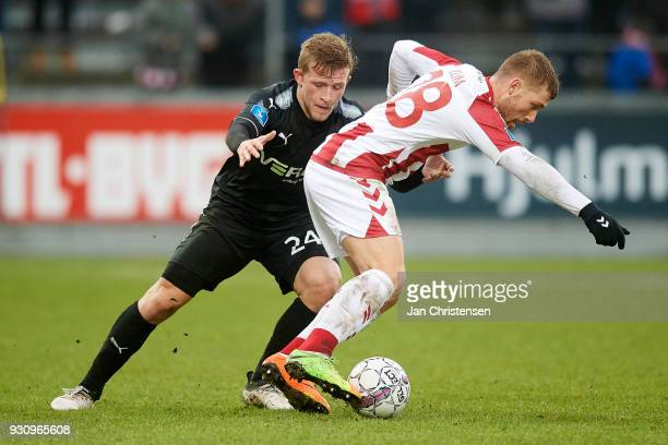 Jonas Bager of Randers FC and Yann Rolim of AaB Aalborg compete for the ball during the Danish Alka Superliga match between AaB Aalborg and Randers...
