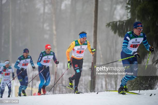 Jonas Baumann of Swiss, Jonas Dobler of Germany, Markus Vuorela of Finnland compete during the Men's Relay 4x7.5km M at the Coop FIS Cross-Country...