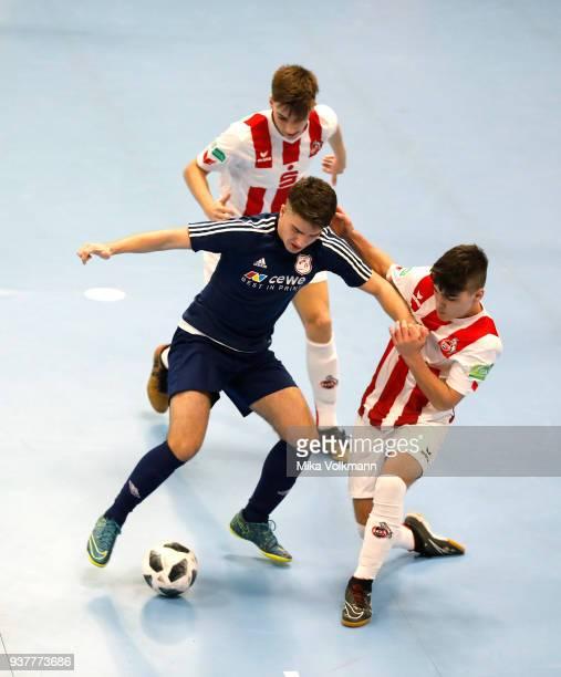 Jonas Berg of 1FC Koeln challenges Erolind Olluri of Arsten during the final of the DFB Indoor Football match BJunioren between 1FC Koeln and TuS...