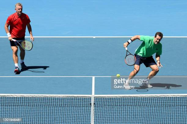 Jonas Bjorkman and Thomas Johansson of Sweden play during their Men's Legends Doubles match against Tommy Haas of Germany and Mark Philippoussis of...