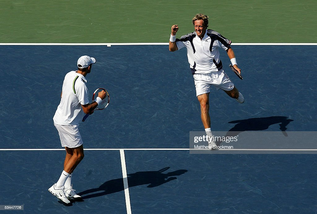 Jonas Bjorkman of Sweden and Max Mirnyi of Belarus celebrate their win over Kevin Ullyett and Wayne Black of Zimbabwe during the final of the Western & Southern Financial Group Masters on August 21, 2005 the Lindner Family Tennis Center in Mason, Ohio.