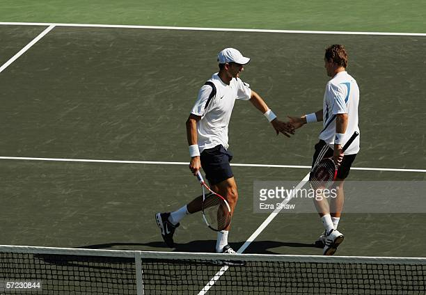 Jonas Bjorkman of Sweden and Max Mirnyi of Belarus high five after winning a point over Mike and Bob Bryan in the men's doubles final at the...