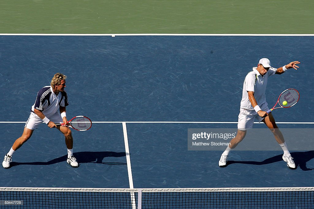 Jonas Bjorkman of Sweden and Max Mirnyi of Belarus play Kevin Ullyett and Wayne Black of Zimbabwe during the final of the Western & Southern Financial Group Masters on August 21, 2005 the Lindner Family Tennis Center in Mason, Ohio.