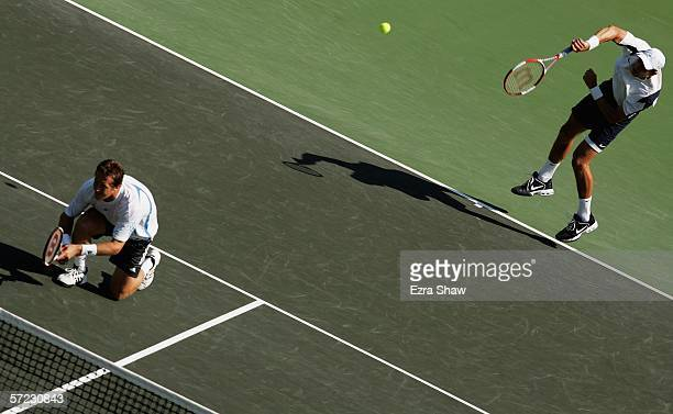 Jonas Bjorkman of Sweden and Max Mirnyi of Belarus serve to Mike and Bob Bryan in the men's doubles final at the Nasdaq100 Open at the Tennis Center...
