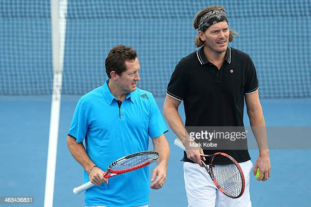 Jonas Bjorkman of Sweden and Thomas Enqvist of Sweden in action in their first round legends doubles match against Joshua Eagle of Australia and...