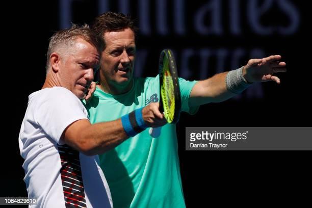 Jonas Bjorkman of Sweden and Thomas Johansson of Sweden in their Men's Legends Doubles against John McEnroe and Patrick McEnroe of the United States...
