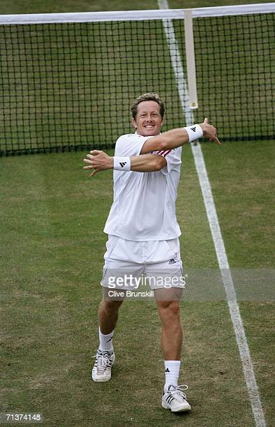 Jonas Bjorkman of Sweden gives a hug to the crowd in celebration of his victory over Radek Stepanek of Czech Republic during day nine of the...
