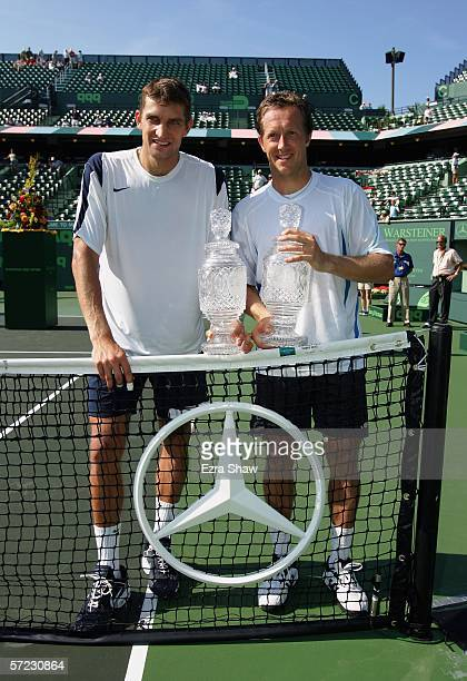 Jonas Bjorkman of Sweden his partner Max Mirnyi of Belarus pose with their trophies after winning the men's doubles final by defeating Mike and Bob...