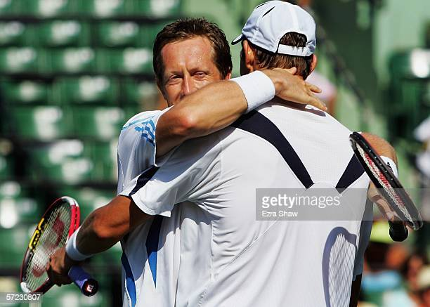 Jonas Bjorkman of Sweden hugs his partner Max Mirnyi of Belarus after winning the men's doubles final by defeating Mike and Bob Bryan at the...