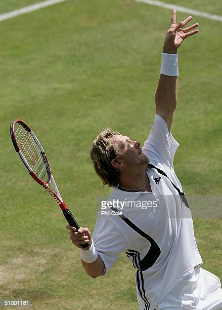 Jonas Bjorkman of Sweden in action during his third round match against Joachim Johansson of Sweden at the Wimbledon Lawn Tennis Championship on June...