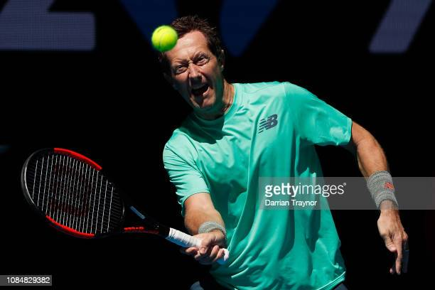 Jonas Bjorkman of Sweden plays a forehand in his Men's Legends Doubles match with Thomas Johansson of Sweden against John McEnroe and Patrick McEnroe...