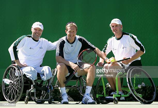 Jonas Bjorkman of Sweden poses with Australian wheelchair tennis players David Hall and Ben Weekes on day eight of the Australian Open 2007 at...