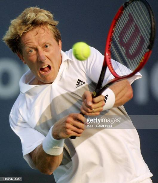 Jonas Bjorkman of Sweden volleys back to Greg Rusedski of Great Britain during their second round match at the US Open at Flushing Meadows, New York,...