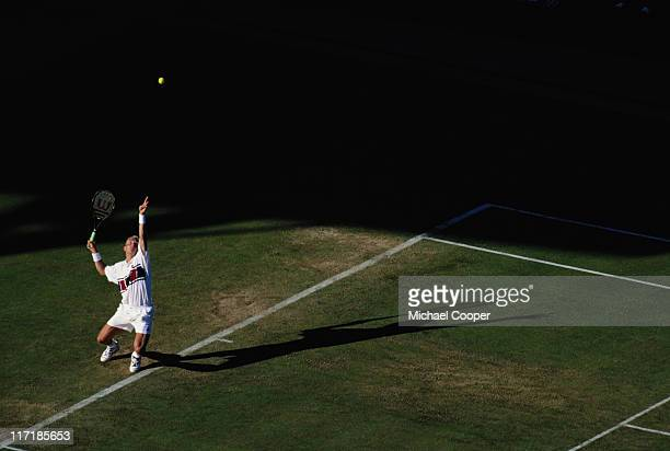 Jonas Bjorkman serves with a lengthening shadow across the court to Wayne Ferreira during their Men's Singles match at the Wimbledon Lawn Tennis...