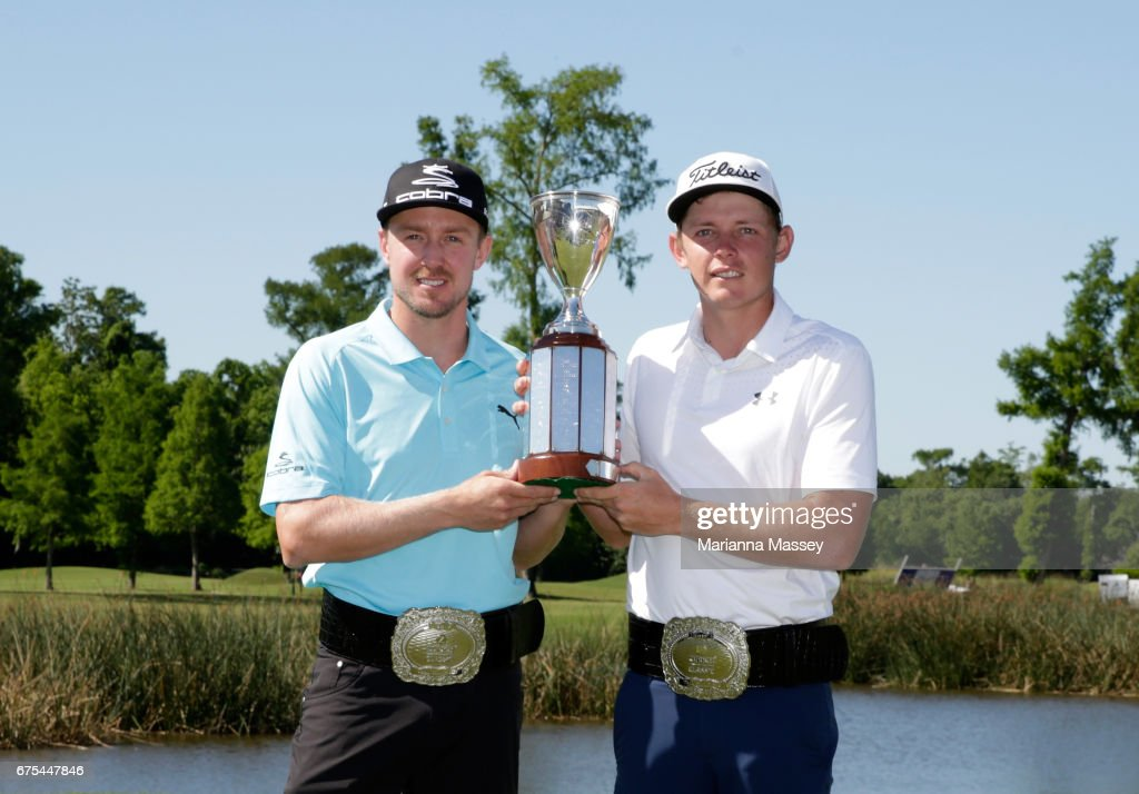 Jonas Blixt of Sweden and Cameron Smith of Australia pose with the trophy after winning in a sudden-death playoff during a continuation of the final round of the Zurich Classic at TPC Louisiana on May 1, 2017 in Avondale, Louisiana.