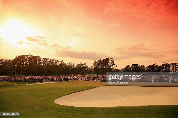 Jonas Blixt of Sweden and Matt Kuchar of the United States are seen on the 18th green during the final round of the 2014 Masters Tournament at...