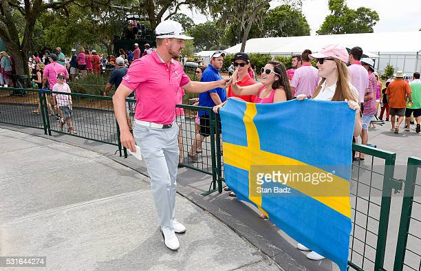 Jonas Blixt of Sweden high fives with a fan during the final round of THE PLAYERS Championship on THE PLAYERS Stadium Course at TPC Sawgrass on May...