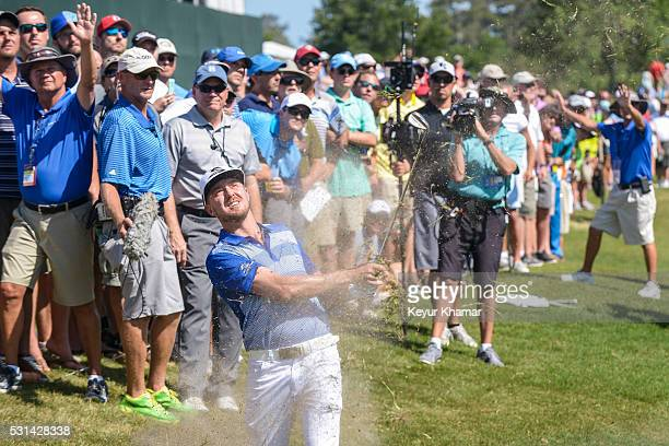 Jonas Blixt of Sweden hits a shot from the rough on the ninth hole as fans watch during the third round of THE PLAYERS Championship on THE PLAYERS...