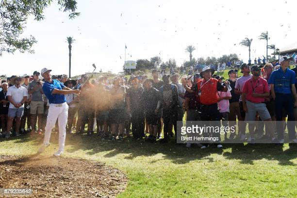 Jonas Blixt of Sweden hits an approach shot on the 18th hole during day four of the 2017 Australian Golf Open at The Australian Golf Club on November...