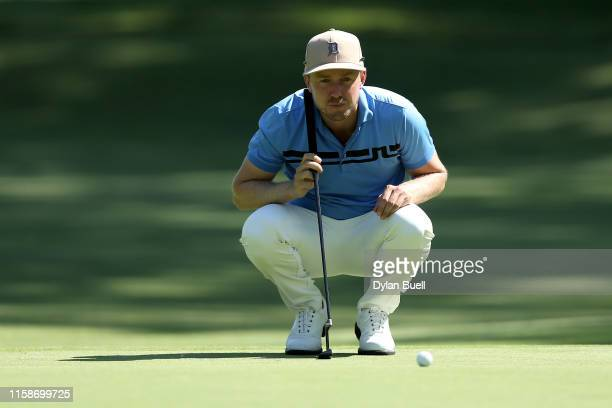Jonas Blixt of Sweden lines up a putt on the fourth green during round one of the Rocket Mortgage Classic at the Detroit Country Club on June 27,...