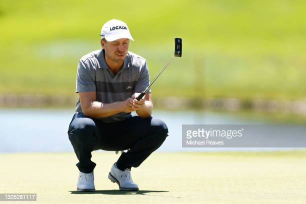 Jonas Blixt of Sweden looks over a putt on the eighth green during the first round of the Travelers Championship at TPC River Highlands on June 24,...