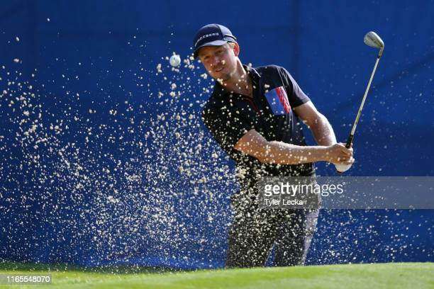 Jonas Blixt of Sweden plays a shot from a bunker on the 15th hole during the first round of the Wyndham Championship at Sedgefield Country Club on...