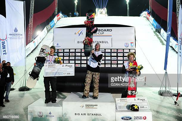 Jonas Boesiger second place Seppe Smits in first place and Brandon Davis third place take the podium for the FIS World Cup men`s Snowboard Big Air...
