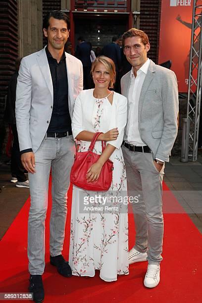 Jonas Boldt and Stefan Reinartz with his wife attend the 11FREUNDE Meisterfeier 2016 at Rheinterrassen on August 13 2016 in Duesseldorf Germany