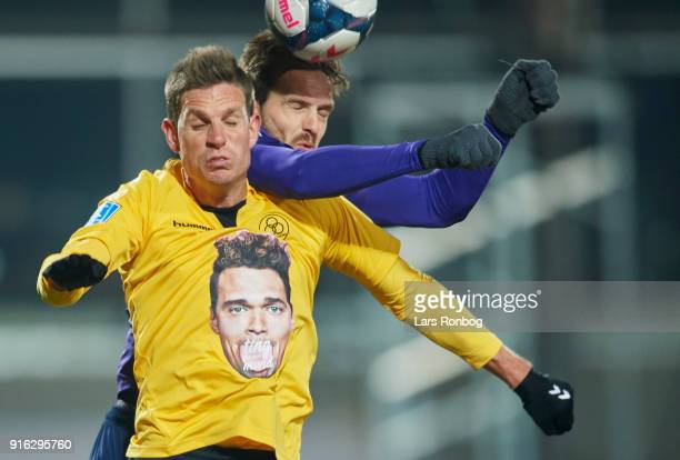 Jonas Borring of AC Horsens and Kian Hansen of FC Midtjylland compete for the ball during the Danish Alka Superliga match between AC Horsens and FC...