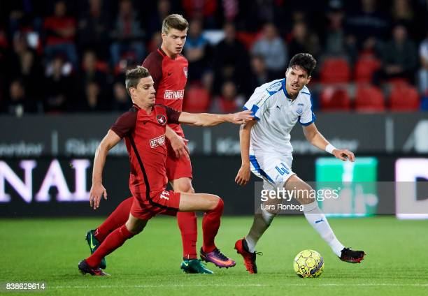 Jonas Borring of FC Midtjylland Alexander Sorloth of FC Midtjylland and Hector Yuste of Apollon Limassol FC compete for the ball during the UEFA...