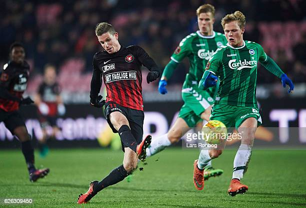 Jonas Borring of FC Midtjylland and Jeppe Tverskov of OB Odense compete for the ball during the Danish Alka Superliga match between FC Midtjylland...