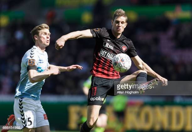 Jonas Borring of FC Midtjylland and Kees Luijckx of SonderjyskE compete for the ball during the Danish Alka Superliga match between FC Midtjylland...