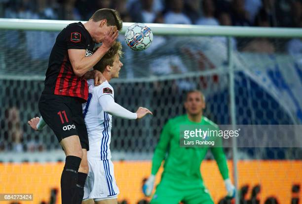 Jonas Borring of FC Midtjylland and Mads Roerslev Rasmussen of FC Copenhagen compete for the ball during the Danish Alka Superliga match between FC...
