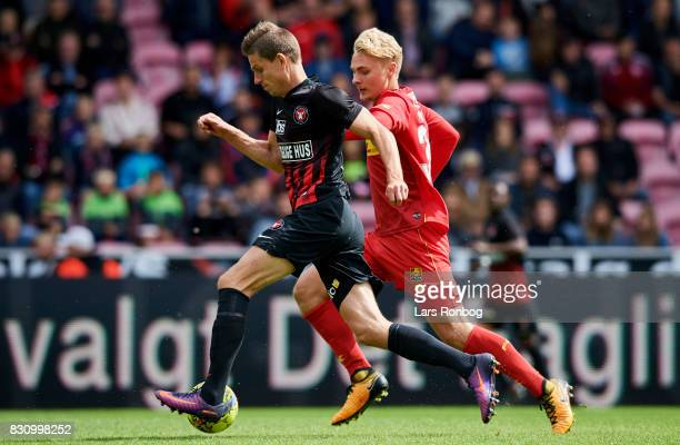 Jonas Borring of FC Midtjylland and Victor Nelsson of FC Nordsjalland compete for the ball during the Danish Alka Superliga match between FC...