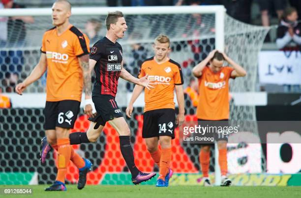 Jonas Borring of FC Midtjylland celebrates after scoring their third goal during the Danish Alka Superliga Europa League Playoff match between FC...