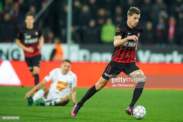 Jonas Borring of FC Midtjylland controls the ball during the Danish Alka Superliga match between FC Midtjylland and Viborg FF at MCH Arena on...