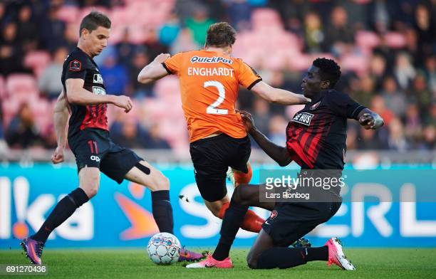 Jonas Borring of FC Midtjylland Kasper Enghardt of Randers FC and Paul Onuachu of FC Midtjylland compete for the ball during the Danish Alka...