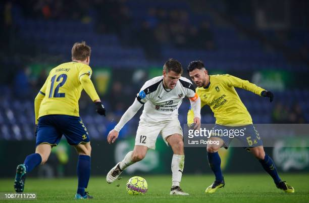 Jonas BrixDamborg of Hobro IK and Besar Halimi of Brondby IF compete for the ball during the Danish Superliga match between Brondby IF and Hobro IK...