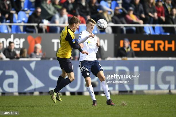 Jonas BrixDamborg of Hobro IK and Kasper Junker of AGF Aarhus compete for the ball during the Danish Alka Superliga match between Hobro IK and AGF...