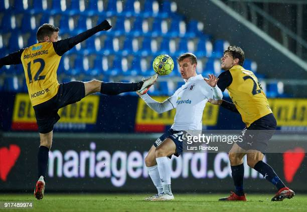 Jonas BrixDamborg of Hobro IK Martin Pusic of AGF Aarhus and Rasmus Minor Petersen of Hobro IK compete for the ball during the Danish Alka Superliga...