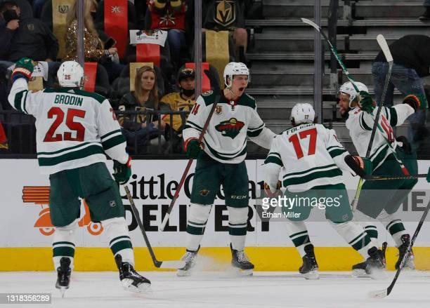 Jonas Brodin, Joel Eriksson Ek, Marcus Foligno and Jordan Greenway of the Minnesota Wild celebrate after Eriksson Ek scored an overtime goal against...