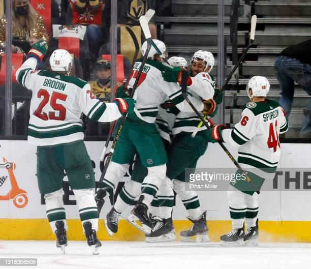 Jonas Brodin, Marcus Foligno, Joel Eriksson Ek, Jordan Greenway and Jared Spurgeon of the Minnesota Wild celebrate after Eriksson Ek scored an...