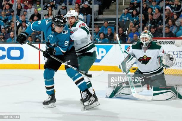 Jonas Brodin of the Minnesota Wild defends Timo Meier of the San Jose Sharks as Devan Dubnyk of the Minnesota Wild protects the net at SAP Center on...