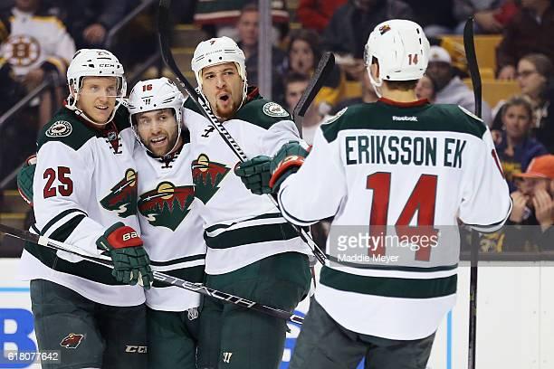 Jonas Brodin of the Minnesota Wild Jason Zucker and Joel Eriksson Ek congratulate Chris Stewart after he scored against Boston Bruins during the...