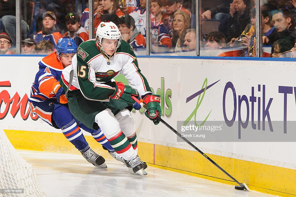 Jonas Brodin #25 of the Minnesota Wild skates against Taylor Hall #4 of the Edmonton Oilers during an NHL game at Rexall Place on April 16, 2013 in Edmonton, Alberta, Canada.