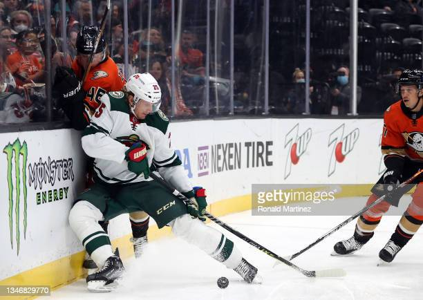 Jonas Brodin of the Minnesota Wild skates the puck against Jared Spurgeon of the Minnesota Wild in the first period at Honda Center on October 15,...