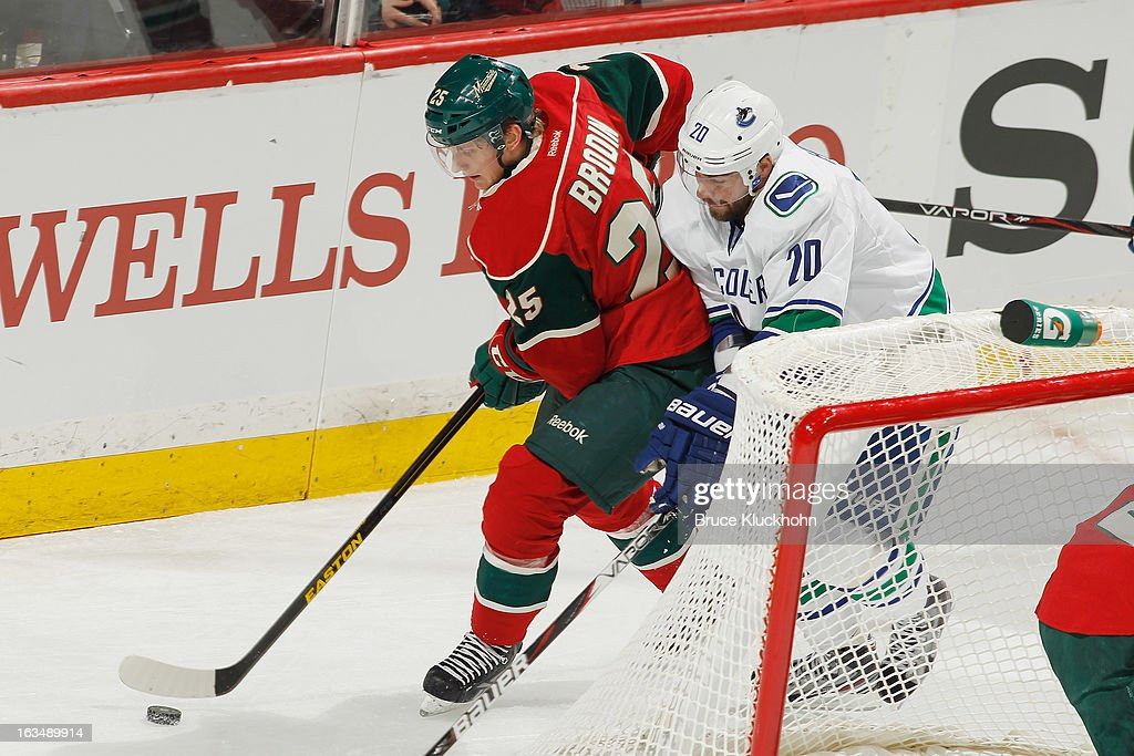 Jonas Brodin #25 of the Minnesota Wild skates with the puck while Chris Higgins #20 of the Vancouver Canucks defends during the game on March 10, 2013 at the Xcel Energy Center in Saint Paul, Minnesota.